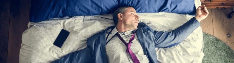 Drunk business man falling asleep